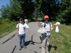 Blair and Jen with the snakes we caught on North Bass Island.